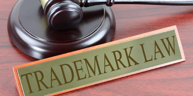 Trademark and a judge gavel on desk - concept of trademark registration.