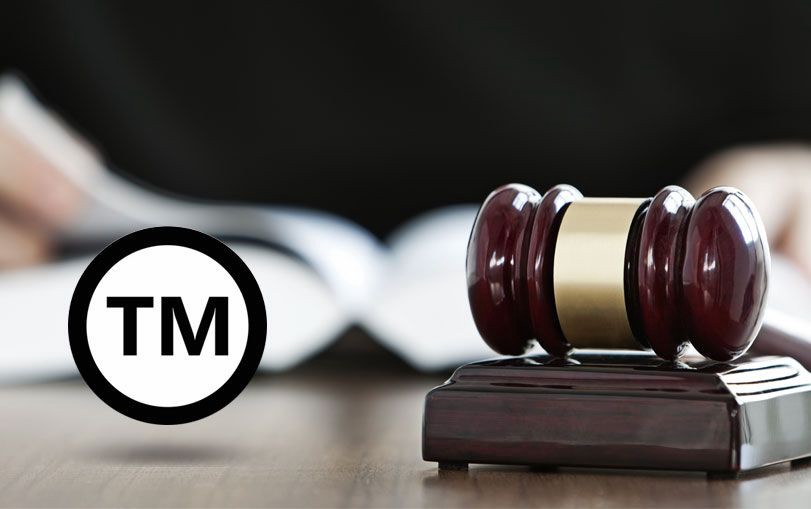 Registered trademark law business concept with trademark mark symbol and gavel.